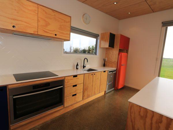 <span>Bespoke Colourful Kitchen</span><i>→</i>