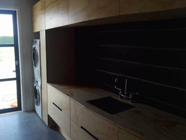 <span>Plywood Laundry</span><i>→</i>